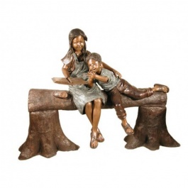 Boy and girl reading on log